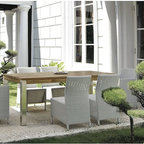 Outdoor Dining Furniture - The Vigo Collection from Mamagreen™ features wicker dining chairs and a dining table with a recycled teak table top.