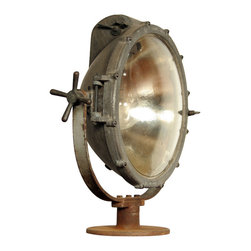 Vintage Industrial Crouse Hinds Light Fixture - This large, fantastic-looking light fixture was made by Crouse-Hinds of Syracuse, NY and is in perfect working condition with an ecellent industrial patina. The curved glass lens is unblemished, as is the half-inch thick mercury glass reflector inside the lamp. It's currently equipped with its original 500 watt mogul base bulb--which still works!--but can be easily converted to standard household bulbs with an inexpensive, widely-available adaptor. This fixture stands by itself very nicely, but could also be mounted on a base to act as a floor lamp.