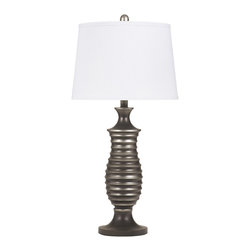 "Signature Design by Ashley - 28"" Rory Set of (2) 3-Way Table Lamps L202904 - Famous Brand Lamps presents the Set of (2) 1-Light Rory Table Lamps, featured in Antique Pewter finish and complemented by a White Drum Shade, creating a harmonious and captivating mood in your home. The base of this lamp looks like it might have just come off a potter's wheel with its decorative banding and gradating finish."