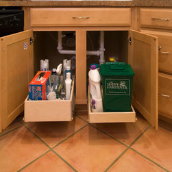 ShelfGenie Pull Out Shelves for Under the Sink - This under-sink cabinet features a double-height pull out shelf on the left and a single-height pull out shelf on the right.  Each shelf is custom made, allowing for obstacles which reside in the cabinets beneath the sink.  Don't let garbage disposals and pipes get in your way!