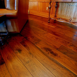 Chateau Walnut, Footworn Texture, French Bleed Effect, Hand Chiseled Square Pegs - Wide Plank walnut with a rich stain can fit any design style. The texture and detailing of the effects added make this floor a centerpiece of the house.