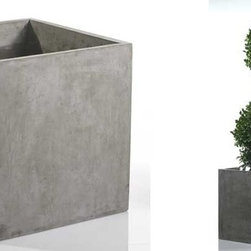 Newport Square Concrete Planter - The Newport Collection features sleek, industrial designs cast from heavy duty fiberglass with a realistic natural grey concrete finish. The Newport Square Concrete Planter is the perfect compliment to your contemporary indoor houseplant or outdoor landscaping. Use solo or in multiples for a clean but dramatic plant display. The Newport Square Concrete Planter does not have a drain hole, so it is ideal for indoor applications (we recommend using a liner).  Or drill a drain hole for outdoor applications. The Newport Square Concrete Planter is available in 16-inch or 20-inch widths.  When not used as a planter, the Newport Square can be flipped upside down and used as a cube seat, side table, or plant stand.