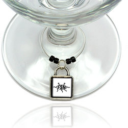 "Made on Terra - Flying Spaghetti Monster Wine Glass Silver Charm - Your guests have arrived and the atmosphere is electric. A sip of wine here, a sip of a cocktail there and you find the conversation turning to the charming baubles you've placed on the glasses, something special you chose for each of your eclectic guests. They love them and appreciate your thoughtfulness. You love them for their uniqueness and that no one forgets which glass they were using.  Choose from Made on Terra's many designs for the best party ever. Ring is 1"" diameter; measures 2"" from top of ring to bottom of charm. Made of metal and plastic. Sold individually."