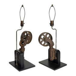 Pre-owned Mounted Caster Table Lamps - A Pair - These lamps won't be wheeling around anytime soon! A great pair of vintage casters mounted and converted into unique table lamps. A fantastic industrial chic addition to any decor.