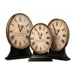 "Kathy Kuo Home - Hammersmith Brass & Wood Desk Clocks- Set of 3 - Pardon, but do you have the time? Elegant timepieces ensure you will always leave on the dot. Harkening back to a time when desk clocks were a staple of refined living, these reproductions of antique clocks have been scaled up and elongated into ovals so they will fit in narrower spaces as a set. Stamped with the words ""Liverpool Street Station,"" this set of hypnotizing clocks will take your imagination on a ride each time you check the time."