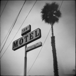 """SURF MOTEL"" Artwork - Iconic Surf Motel sign and lone palm tree black and white toy camera photo signed by Daniel Grant. From the series 'sand people,' this foggy skyward study, printed on hahnemuhle bamboo sustainable paper and using soy based inks, is delivered unframed and unmatted."