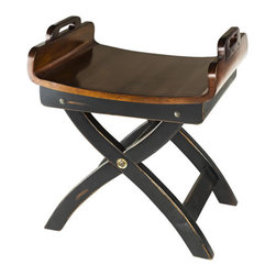 """Fireside Stool - The fireside stool measures 20.5"""" x 15.75"""" x 23.75"""". Admire its sturdy, classic construction details. Try out the curved seat. Surprisingly comfortable and utilitarian, considering a stool is often relegated to the nether regions of the furniture hierarchy. Grab the side handles that make it so easy to move around. And it tucks away easily under a side table or desk. The stool is made from plantation grown hardwood. It's French distressed finished in black and honey colors. The stool does not fold up."""