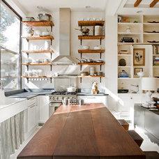Wood shelves in white kitchen