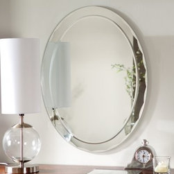 Frameless Aldo Wall Mirror - 23.5W x 31.5H in. - Add a beautiful contemporary element in the bathroom entryway or hallway with the Frameless Aldo Wall Mirror. This stunning oval mirror is sure to add elegance to any wall in your home. Constructed of metal and strong 3/16 glass it features polished beveled edges with a scalloped design. Mounting hardware is included with the mirror. Weighs 14 pounds. Dimensions: 31.5L x 23.5W x .5D inches.