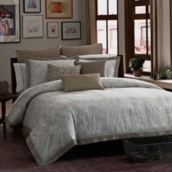 Kenneth Cole Reaction Home - Kenneth Cole Reaction Home Python Comforter - This luxuriously soft Python animal print comforter brings clean, sophisticated taste to your bedroom in soft neutrals with hints of silver metallic. A sheer silver organza taping detail adds to this comforter's delicate beauty.