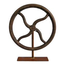 Salvatecture Studio - Vintage Industrial Wheel on Stand - Big wheel, keep on turning. This vintage wheel on a reclaimed iron stand is perfect if you have a love of found industrial objects. Measuring 20-inches high by 15-inches wide by 3-inches deep, this collectible item will look right at home on your mantle.
