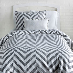 Tiled Chevron Duvet Cover and Sham Set - Distressed to impress. A fresh departure from the classic chevron print, the Tiled Chevron Duvet Cover and Sham Set featured a tiled chevron pattern in a distressed texture giving it a cool architectural vibe. Rich charcoal is printed on a crisp white cotton duvet cover and sham(s) making this set easy to pair with any color accessories. Made from 100% cotton sateen, this soft,  grey chevron duvet cover and sham set  is perfect for a classic gal with a little bit of edge. Featured a hidden zipper closure for easy bed making.