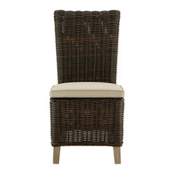 Finn Outdoor Dining Chair with Cushion - These worry free, all-weather wicker pieces will withstand nature's elements while adding beauty, comfort and style to your backyard garden, deck, rooftop patio, porch or sunroom. Made for year-round use and enjoyment, Finn pieces are made of an aluminum frame that is wrapped in a woven resin to create the appearance of natural wicker. Cushions make it suitable for lounging away the summer days or entertaining with family and friends on cool moonlit evenings.