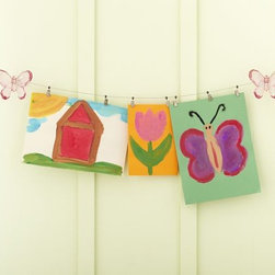 Butterfly Art Cable System - A classic and fun way to display art, this 10-foot-long art cable mounts onto the wall with butterflies accenting each end. The cable comes with 10 clips for hanging artwork. This item is also available in flower, star, seahorse and shark details.