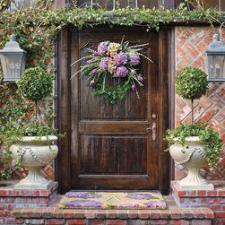 Frontgate - Purple Hydrangea Wreath - Faux flowers, artistically arranged. Suitable for indoor and outdoor use. Durable and maintenance free. Tulips and hydrangea make a stunning springtime wreath that won't lose its luster. The strikingly realistic deep lavender flowers burst forth from this gorgeous Purple Hydrangea Wreath.  .  .  . Imported.