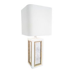 Couture - Couture Century City Gloss White Table Lamp - Accent your modern decor with the old Hollywood glamour of this eye-catching glossy white table lamp with an opulent silver trim around aged mirror panels. Bring home the right kind of drama with this stunning Couture Century City table lamp in glossy white. The tall, rectangular base is gorgeously finished with aged mirror panels trimmed in shimmering silver and white lacquer. The shade on top is a beautiful white linen square hardback with soft corners, just a bit wider than the base. Place this beautiful table lamp beside a favorite armchair to create the perfect place to relax is style.