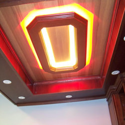 """Bar - We remodel a basement and installed a Block """"O"""" in the upper part of a tray ceiling in a bar, With red LED lighting around the exterior of it and white in the interior. The Block """"O"""" was made out of cherry wood with the rest of the bar made out of Hickory stain in a Amber for the upper back ground and a dark Brandy for the drop tray."""