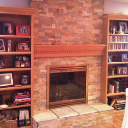 RealStone Systems - Stone Fireplace Projects - For this job we covered over their existing dated stacked brick with a real stone veneer from RealStone Systems. We also removed their existing hearth stones and replaced with a matching hearth stones in Sierra. The mantel and bookshelves stayed, but have a whole new look!