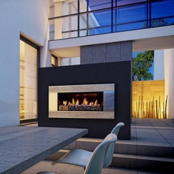 Escea Verta Travertine Outdoor Gas Fireplace Insert - Create the perfect ambiance for your outdoor living space with the contemporary style of the Escea Verta Travertine Outdoor Gas Fireplace Insert. This stunning fireplace insert features a stainless steel border accented with travertine fascia inserts. It provides your setting with up to 56,000 BTUs of heating power. Installing it is easy as it requires no venting and can be added straight into any timber framed external construction, suitable wall, or masonry cavity. Use liquid propane or natural gas for fuel. Complete the look of this fireplace with your choice of available fuel bed rock options. Note: Review any building restrictions or construction permit requirements before installation of an outdoor fireplace. Contact your local zoning commission/homeowners association for details. Contact a licensed contractor for installation as this product may require connection to a natural gas line. About EsceaEscea was founded in 2002 in New Zealand on the idea that the home fireplace should not only be functional but remarkably beautiful as well. Since their beginning the company has become a leader in the industry, designing, manufacturing, and distributing quality gas burners and outdoor fireplaces. Escea's success has given them a world-wide clientele and has garnered them multiple awards recognizing their talents and product designs.