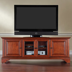 Crosley - Crosley LaFayette 60 in. Low Profile TV Stand - Classic Cherry Multicolor - KF10 - Shop for Visual Centers and Stands from Hayneedle.com! The lower stature of this Crosley LaFayette 60 in. Low Profile TV Stand - Classic Cherry makes it perfect in the bedroom. It accommodates most 60-inch flat panel TVs and houses all your media components. This TV stand is made of hardwood and quality veneers with a hand rubbed multi-step classic cherry finish accented with antique brass hardware. Two raised panel doors conceal stacks of DVDs games and media components while tempered glass doors protect electronic components from dust and allow remote control access. Three adjustable shelves offer plenty of versatile storage while the cord management feature tames the unsightly mess of tangled wires.Additional Features:Accommodates up to a 60-inch flat panel TV3 adjustable shelves give 6 levels of protected storageDual tempered glass doors allow remote control access2 side cupboards with raised panel doors and 1 adjustable shelf eachCord management featureAbout Crosley FurnitureIn 1920 Powel Crosley founded the company that pioneered radio broadcasting and mass market manufacturing around the world starting with a simple radio meticulously crafted with obsessive detail and accuracy and a measure of consideration for the wallet. These high ideals have served the company well for over 90 years and they live on in the newest addition to the family. Crosley Furniture sets a new standard for innovation function and meticulous craftsmanship in the manufacture of value-priced furniture. They proudly offer durable furniture products featuring hardwood and veneer construction with rich multi-step finishes in a multitude of styles.