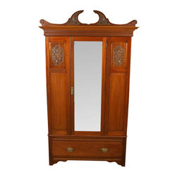 Antiques - Antique Victorian Mahogany Wardrobe Armoire - Origin:England. Circa 1890. Mahogany Finish. Solid Wood Construction. Late Victorian Styling. Carved Split Swan Neck Pediment. Molded Crown. Paneled Cabinet Front Paneled Interior. Large Accent Carvings. Large Bevelled Edge Mirror. Ornate Drop and Bail Pulls. Dovetail Joinery. Excellent Condition for Age. This beautiful antique mahogany armoire has a split swan neck pediment with accent carving, a large rectangular mirror on the single cabinet door, and exquisite paneled accent carvings on either side of the mirror. The bevelled edge mirror is very clean almost suggesting that is has been replaced but I found no evidence to support that it is not the original. The cabinet door has an ornate solid drop pull and the drawer has two large decorative bail pulls. The skirt is arched on the side of the piece and there are scalloped brackets on the front. The interior is paneled and has two mounted hooks and 6 sliding hooks on the hanging bar. A very nice piece in remarkable condition for the age (circa 1890), this armoire is certain to become a cherished heirloom.Condition: There are some wear or moving marks on the left side of the cabinet and on the inside of the cabinet door. There is a small opening at the top right of the left front panel. These minor imperfections are to be expected in a piece of this age and do not distract from the overall stunning beauty.