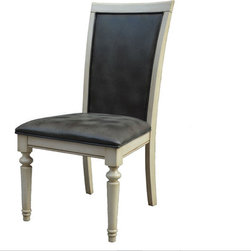 Turner White Dining Chair - The Turner Dining Chair is a perfect mix of elegance and tradition. The beautiful white antique finish on the wood is complemented by the distressed upholstery on seat cushion and back.