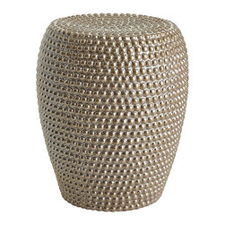 THREE HANDS - Ceramic Beaded Stool - This glamorous garden stool is crafted from simple, sturdy ceramic—which has been fired, embossed and pearlized to a gemlike shine. So you can actually sit on it and everything.