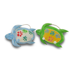 Zeckos - Charming Wood Sea Turtle Double Peg Wall Hook Set of 2 - This pair of sea turtles will swim their way into your home and onto your walls with their hand-painted charm and character Crafted from wood, these set of blue and green turtles have decorative backs and feature 2 pegs for hanging items such as hats, coats, towels and robes. Perfect for a child's room, this adorable pair will make it easy for little hands to hang items when placed lower on a wall. These would make a delightful accent in a nursery, bathroom or bedroom Each turtle measures 11 1/4 inches long, 7 3/4 inches high and 2 1/2 inches deep, easily hang on the wall with the attached rope hanger, and would make a great shower or holiday gift