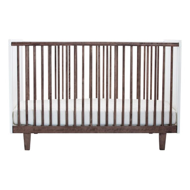 Oeuf Rhea Crib, Walnut - Some cribs are bulky, but this one looks light and airy with its slender slats. I think it has an elegant, masculine look.