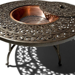 Strathwood St. Thomas Cast-Aluminum Firepit With Table - This firepit is too fancy for a caveman, but perfect for a feminine space. I'd love to toast marshmallows with it.