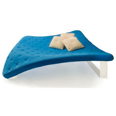 modern day beds and chaises by Purcell Living