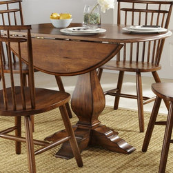 Liberty Furniture - Creations II Pedestal Dining Table - Chairs sold separately. Two drop leaves. Butcher block top. Comfortably seats upto 4. Warranty: One year. Made from select hardwoods. Tobacco finish. Made in Malaysia. Minimum: 26 in. L x 42 in. W x 30 in. H. Maximum: 42 in. Dia. x 30 in. H (80 lbs.)