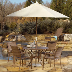 Hospitality Rattan - Panama Jack Island Cove Woven Slatted Patio Dining Set - Seats 4 Multicolor - PJ - Shop for Tables and Chairs Sets from Hayneedle.com! Just because Mother Nature didn't RSVP to your Memorial Day brunch doesn't mean that she won't show but no matter the weather or occasion the Panama Jack Island Cove Woven Slatted Patio Dining Set - Seats 4 is ready for the challenge. This charming set features classically inspired lines and a warm hue on the powder-coated espresso finish that makes it an ideal addition to any patio decor style. Each piece is crafted from lightweight rustproof aluminum making it resistant to corrosion and staining outdoors. The seats and seat backs incorporate a material known as Viro a synthetic wicker that has all the charm and feel of real wicker while boasting superior durability and resistance to fading and rot. The slat-top table gives you a sturdy functional surface that's lightweight and easy to maintain and the central umbrella hole lets you add an umbrella for those sunny days.About Hospitality RattanHospitality Rattan has been a leading manufacturer and distributor of contract quality rattan wicker and bamboo furnishings since 2000. The company's product lines have become dominant in the Casual Rattan Wicker and Outdoor Markets because of their quality construction variety and attractive design. Designed for buyers who appreciate upscale furniture with a tropical feel Hospitality Rattan offers a range of indoor and outdoor collections featuring all-aluminum frames woven with Viro or Rehau synthetic wicker fiber that will not fade or crack when subjected to the elements. Hospitality Rattan furniture is manufactured to hospitality specifications and quality standards which exceed the standards for residential use.Hospitality Rattan's Environmental Commitment Hospitality Rattan is continually looking for ways to limit their impact on the environment and is always trying to use the most environmentally friendly manufacturi