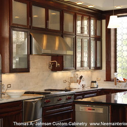 Thomas A. Johnson Custom Kitchen Cabinetry- Mahogany - This handsome custom kitchen cabinet installation was designed and crafted for a client in Virginia by celebrated craftsman and artisan Thomas A. Johnson. Known for his incredible attention to detail and exceptional craftsmanship, Thomas A. Johnson crafted this exquisite kitchen cabinet installation out of rich recycled mahogany, maximizing functionality and space. Thomas A. Johnson custom cabinetry is made in the USA from 100% solid and recycled wood ensuring that your custom cabinet order not only helps promote USA based jobs but also works to promote green and sustainable furniture production practices. The addition of Thomas A. Johnson custom cabinetry to your home will add value to your home investment as Thomas A. Johnson custom cabinetry and furnishings are quickly becoming quite the treasured possession of homeowners and collectors throughout the US. Cabinets and furniture feature skillfully constructed dovetail joints, mortise and tenon wood pegged joints, rich wood grain detail and exquisitely fashioned hardware. Each design is a functional work of art that will be treasured by generations for years to come.