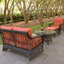 Woodard Serengeti All Weather Wicker Conversation Patio Set - Seats up to 4 - Avoid the mismatched patio furniture doldrums with the Woodard Serengeti All Weather Wicker Conversation Patio Set - Seats up to 4, a pretty, practical set that comes in several configurations to best suit your entertaining needs.Every piece starts with durable, all-weather resin wicker, hand-woven over a sturdy aluminum frame built to withstand every gathering. Available in both configurations is a chat table, which features tightly woven wicker along the tabletop sides and base, lightly shaped and footed with four short legs. Adding modern flair is a round, clear glass tabletop that eliminates worry about drink spills - just wipe it with a clean, soft cloth. Also included in both sets is a gliding loveseat, which seats two and has a smooth gliding mechanism behind the curved bottom apron, and one or two compact coordinating ottomans. Choose one or two stationary lounge chairs as well - they, along with the loveseat, lighten the look with beautiful, branch-like open weaving on the sides and back.The loveseat, ottoman, and lounge chairs boast simple, modern square cushions, available in a range of organic shades and all made of super-practical Sunbrella fabric that boasts a five-year warranty against fading. Each wicker piece is maintenance-free - hose off the wicker each season to keep it fresh. Everything is is shipped fully assembled, too, for immediate use and includes a three-year limited warranty. Choose the chat table, loveseat, two chairs, and two ottomans; or the chat table, loveseat, one chair, and one ottoman.DimensionsChat table: 36 diam. x 21H inchesLoveseat: 55W x 33D x 34H inchesOttoman: 30L x 24W x 18H inchesLounge chair: 32W x 33D x 34H inchesAbout Sunbrella FabricSunbrella fabric is breathable and water-repellent. If kept dry, it will not support the growth of mildew as natural fiber will. It's easy to clean, requiring simple dusting off and soap and water. Beautiful and durable, Sunbrella fabric is a name you can trust in your outdoor furniture. Sunbrella fabric comes with a 5-year warranty against fading.All-weather Resin WickerSome of the most beautiful furniture is crafted using man-made resin wicker. Resin wicker is a synthetic plastic colored all the way through and stretched over a metal wire core. The resin is made with UV inhibitors to protect the resin from fading in sunlight. Resin products don't chip, break or get brittle with UV exposure. It's a beautiful, long-lasting choice in furniture that's easy to care for, requiring an occasional dusting and wipe-down with a damp cloth.Important NoticeThis item is custom-made to order, which means production begins immediately upon receipt of each order. Because of this, cancellations must be made via telephone to 1-800-351-5699 within 24 hours of order placement. Emails are not currently acceptable forms of cancellation. Thank you for your consideration in this matter.Woodard: Hand-crafted to Withstand the Test of TimeFor over 140 years, Woodard craftsmen have designed and manufactured products loyal to the timeless art of quality furniture construction. Using the age-old art of hand-forming and the latest in high-tech manufacturing, Woodard remains committed to creating products that will provide years of enjoyment.Most Woodard furniture is assembled by experienced professionals before being shipped. That means you can enjoy your furniture immediately and with confidence.Together, these elements set Woodard furniture apart from all others. When you purchase Woodard, you purchase a history of quality and excellence, and furniture that will last well into the future.Read more about the Woodard Guarantee by clicking the link on the product page.