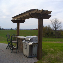 """Timber Arbor w/ Patio - Timber framed pavilion constructed using rough-cut Hemlock, covering a Techo-Bloc """"Athena"""" paver patio."""