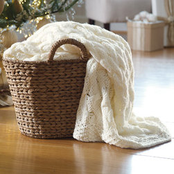 Grandin Road - Hand Knitted Throw - Cable-knit, winter white throw blanket. Hand knitted in 100% acrylic. Cable-knit weave with a garter-stitch border. Makes a great gift. Dry clean. Light the fire and curl up with the comfy-cozy cable knit of the winter white Hand Knitted Throw. A classic garter-stitch border frames the soft, wide cable knit weave, for an elegant look and the feel of your favorite sweater. Its versatile, natural hue makes the perfect holiday gift and sofa-side accessory - order one for yourself and another for your best friend.  .  .  .  .  . Imported.