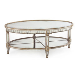 Kathy Kuo Home - Kendrick Hollywood Regency Silver Antique Mirror Coffee Table - Break out the bubbly and celebrate the beauty of Parisian silver - a cool gray metallic, but not completely silver, sheen - and antique mirror with this oval cocktail table. One part Versailles and one part Sunset Boulevard, this Hollywood Regency classic is rimmed with no less than 80 small mirrors and supported by a quartered mirror under shelf.
