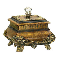 Sterling Industries - Sterling Wilton Keepsake Box - Store your precious photos, important papers, lovely mementos and other treasures in this lovely and elegant wilton keepsake box by Sterling. This storage box is the perfect mix of form and function in a traditional decor. Fanciful carved floral details surround the base and feet. An acrylic crystal sits on top of the removal lid that also has a fancy floral detail. The Sterling wilton keepsake box will be a lovely addition to your desktop or tabletop. Painted in a rich antique gold finish.