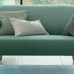 Smooth Sofa - An elegant sage green sofa? Why not? Especially if it's as stylish as this one.