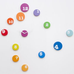 Progetti - Fun Time Wall Clock by Progetti - Since time can be considered an abstract concept, why not keep track of it with an abstract clock? Dotting a wall with punches of bright color, the Progetti Fun Time Wall Clock is a whimsical reminder that, while time may be of the essence, it's important not to take it too seriously. Progetti is an Italian design company that ticks to its own clock. Known for their penchant for keeping a modern tempo, Progetti produces contemporary cuckoo clocks and wall clocks designed by a range of internationally-known designers (like Karim Rashid). Each piece is developed using the latest technology and then finished by hand for that lasting, artistic touch.