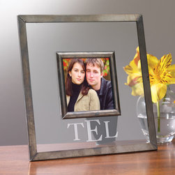 "Exposures - Glass Frame Personalized - Overview Create a gift theyll treasure! This rustic and simple glass photo frame is versatile enough to fit any decor and puts the focus on your photo. For a personal touch, a 3-letter etched monogram is included.  Features Glass frame  Table display    Personalization  3-letter monogram   Specifications  Holds a 3"" x 3"" photo Measures 7"" wide x 7"" high   Shipping  Please allow an additional 2 to 3 days for personalized items"