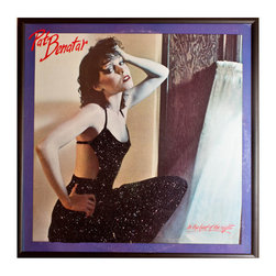 "Glittered Pat Benetar In the Heat of the Night - Glittered record album. Album is framed in a black 12x12"" square frame with front and back cover and clips holding the record in place on the back. Album covers are original vintage covers."