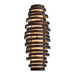 Corbett Lighting - Vertigo Tall Wall Sconce by Corbett Lighting - Truly dizzying style for modern settings. The Corbett Lighting Vertigo Tall Wall Sconce is two feet tall, with a lengthy shade orbited by numerous offset rings of hand-crafted iron. Available in two frame finish/shade color pairings: one cool and silvery, the other deep and golden. Part of the Vertigo collection.Corbett Lighting has been creating and manufacturing beautiful lighting for more than 40 years. Their products clearly demonstrate Corbett's dedication to original design and superior craftsmanship, combined with the finest glassware, shades and natural material. Solid brass castings, Italian glass, hand-forged iron and hand-painted finishes are just a few of the quality materials used in Corbett Lighting fixtures.The Corbett Lighting Vertigo Tall Wall Sconce is available with the following:Details:Cylindrical shadeHand-crafted iron frameUL ListedOptions:Finish and Shade: Bronze and Gold Leaf with Caramel Ice, or Modern Silver with Citrine Ice.Lighting:Three 13 Watt 120 Volt Type GU24 Fluorescent lamps (included).Shipping:This item usually ships within 3-4 weeks.