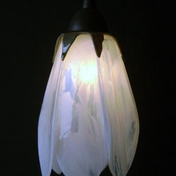 "Glass Pendant Lights - Tulip Shaped - These hand made kiln fired glass tulip shades come in assorted colors and include hardward (bronze, brushed nickel or black).  Shade dimension is 7"" tall."