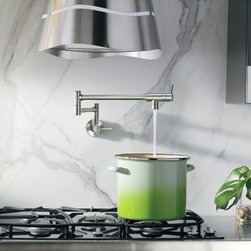 Moen Classic stainless two-handle Pot Filler - Inspire the master chef within: the stylish Pot Filler is convenient and practical. Able to reach all stove burners for filling pots, the folding arm retracts completely when not in use.