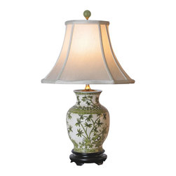 "Lamps Plus - Asian Palm Tree Porcelain Vase Table Lamp - This artistic table lamp looks great in a living room or bedroom and is perfect for traditional or Asian-themed decors. It features a porcelain vase decorated with an exquisite palm tree pattern in green hues. An off white square bell shade sits on top. A three-way socket gives you more lighting control. Porcelain base. Green palm tree motif. Off white square bell shade. Takes one 100 watt three-way bulb (not included). 23"" high. Shade is 6"" across the top 13"" across the bottom 9 1/2"" high.  Porcelain base.   Green palm tree motif.   Off white square bell shade.   Takes one 100 watt three-way bulb (not included).   23"" high.   Shade is 6"" across the top 13"" across the bottom 9 1/2"" high."
