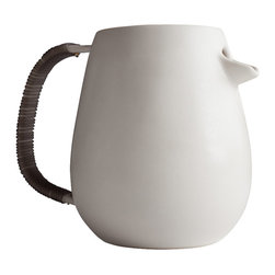 Pigeon Toe Ceramics - Bound Pitcher - This substantial serving vessel is hand-thrown in porcelain, and then glazed in our satin white glaze 'bone' for just a hint of shimmer. Featuring a unique half-spout and a handle wrapped in a semi-translucent gray silicone rubber cord for a comfortable no-slip grip. Not only does it feel great to hold, it also washes easily, and adds a modern edge to an otherwise quiet shape.