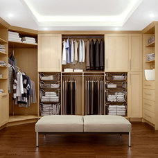 Contemporary Closet by Cabinets & Designs