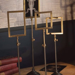 Telescoping Brass Frame Stands - I saw these frames and thought they're a great way to display a variety of collectibles like old postcards or cool etchings in a unique way.
